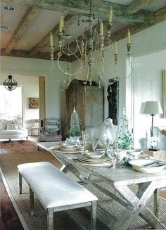Dining Room Shabby Chic - Reclaimed lumber can be stripped and made into a table, or an existing piece can be whitewashed for that signature, worn, shabby-chic look. Place your table on a faded rug and if you have mismatched chairs, unify them with simple slipcovers