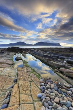 The rock strewn shoreline near Warebeth on Mainland Orkney, with the hills of Hoy in the distance. The image being captured shortly before sunset in late October. Orkney Islands, Gods Glory, Before Sunset, Beautiful Castles, Am Meer, Scottish Highlands, Countries Of The World, Landscape Photography, The Good Place