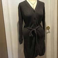 Womens long sweater This is a great sweater for all year round! Ties at waist and buttons down the front. Throw on with ease. Great for the winter months and the chilly spring days and the chilly summer nights! Really nice charcoal gray! This would also fit a medium Charlotte Russe Sweaters V-Necks