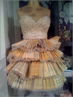 dress made out of music and book pages. clever -- would be cute for part of a wedding dress (if done right)