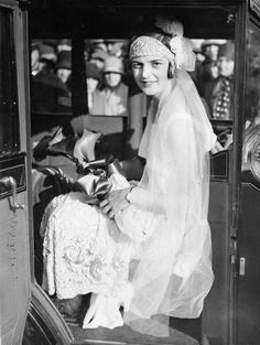 1936 - Famed English tennis player Eileen Bennett wed racehorse trainer Marcus Marsh on September She often wore headbands on the court and chose to walk down the aisle in a headpiece and long veil, which were in fashion at the time. Vintage Wedding Photos, 1920s Wedding, Vintage Bridal, Formal Wedding, Wedding Men, Vintage Weddings, Wedding Pictures, Silver Weddings, Bling Wedding