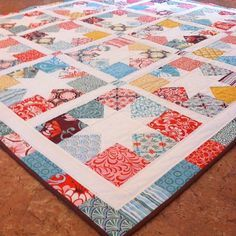 charming stars by cora quilts ~ lovely use of charm packs.
