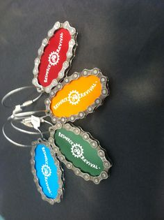 Luggage tags made from recycled bike chains.
