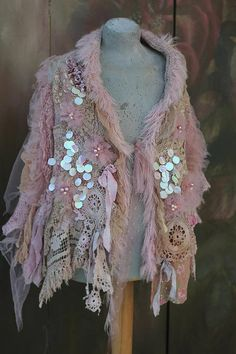 Romantic fairylike cape/ shawlis very ornate, light, delicate looking and can be worn to cover shoulders, use as bold ornate neckwrap; in soft pastel shades of blush, cream, palest mauve, ivory, pale pink, pale peach, antique white. ..Made of hand knitted hand dyed mohair, antique
