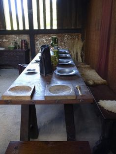 "Medieval Dinner Table  setting - look at the square wooden plates or ""trenchers."" This may have been part of the origin of the term ""square meal."" - http://www.culinarylore.com/food-history:origin-of-phrase-a-square-meal"