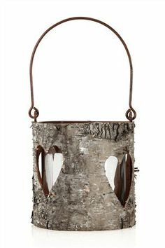 Rustic bark heart cut out lanterns from Next. Perfect for rustic wedding decor.