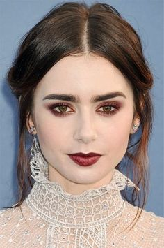 Best Lipsticks of 2016: The Celebrity Beauty Looks to Copy - Lily Collins' dark purple lipstick