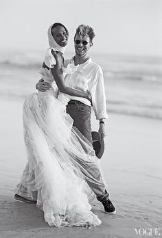 Iman, in a dress by Karl Lagerfeld for Chanel Haute Couture, and David Bowie on the beach at Cape Point Nature Reserve near Cape Town, South Africa,1995.