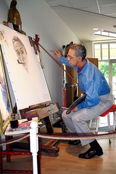 Wax statue of Norman Rockwell doing his famous Triple Self Portrait. Photo by Sue Weisensel.