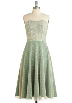 Dashing Damsel Dress from ModCloth ~ A renaissance is taking place in your wardrobe - this romantic gown from Stop Staring! transforms you from everyday darling to reigning princess of chic! Its polka-dotted beige mesh overlay ruches elegantly around your torso, then drops into a dreamy A-line. Emerald satin shines underneath, adding a glamorous glow to your opulent look.