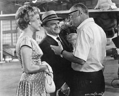 Arlene Francis and James Cagney listen to One, Two, Three director Billy Wilder 1961