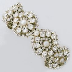 Meg Wedding Jewelry, fabulous bridal cuffs & bracelets. Pearl & crystal round designs create a stunning cuff to complement your wedding gown.  https://perfectdetails.com/deer-bracelet.htm