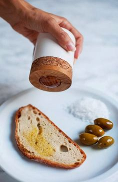 Genius. A roll-on container by Croatian studio Oaza lets you apply olive oil onto your bread without getting messy.