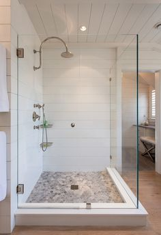Wood-look shiplap. Keep a beach-inspired look going right through the bath without worrying about water damage with Corian sheet, cut to look like shiplap.