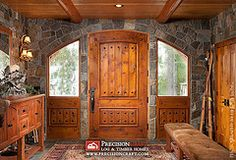 Log home entry, the combination of stone and wood creates a dramatic entry into this intricately handcrafted home.  This is what I would love to have.
