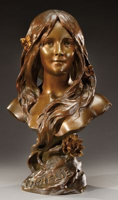 HENRI GODET (1863-1937) brown and gold patina bronze bust of Ophelie with flowers in her hair, on a bronze base imitating a rock. Signed on the back «Henri Godet» foundry stamp «société des bronzes de Paris», monogram «J.P» and numbered. Antique cast, circa 1900. H : 22 ½ in