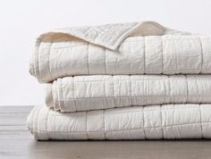 Made from our best-selling 300 TC Organic Sateen, this mid-weight down alternative comforter is cozy, breathable and hypoallergenic. Choose from three classic colors that coordinate with our matching sheets and duvets, perfect for pairing or on its own. Console, Wool Dryer Balls, Cotton Textile, Linen Bedding, Bed Linen, Bedding Sets, King Comforter, Cloth Bags, Houses