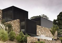Stone and black steel facade Local Rock House - Pattersons Waiheke Island, New Zealand. Architecture Résidentielle, Amazing Architecture, Contemporary Architecture, Peter Zumthor Architecture, Minimalist Architecture, Casa Do Rock, Modern Home Design, Modern Homes, House On The Rock