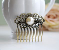 Pearl Hair Comb, Vintage Cream White Pearl Cabochon Antique Brass Filigree Bridal Hair Comb, Wedding Hair Comb, Victorian Art Nouveau by LeChaim on Etsy https://www.etsy.com/listing/106734574/pearl-hair-comb-vintage-cream-white