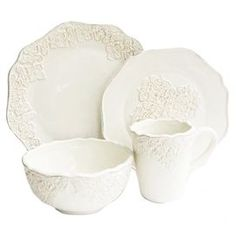 Create a charming tablescape for your family brunch or dinner soiree with this eye-catching design.  Product:  4 Dinner plates4 Salad plates4 Bowls4 MugsConstruction Material: DolomiteColor: WhiteFeatures: Service for fourDimensions: Dinner plate: 10.6 Diameter each Salad plate: 8 Diameter each Bowl: 6 Diameter eachMug: 14 Ounce capacity eachCleaning and Care: Dishwasher safe