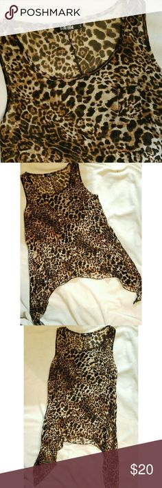 NEW! Sheer Cheetah Print Handkerchief Top (NWOT) This is a cute sheer cheetah print top that is great for a girls night outfit or over the top of a basic tabk or camisole for a more professional look. It is sort of a hi lo top except the sides are long and the middle is high. Danielle Tops Blouses