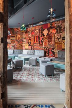 Divan Restaurant | Bucharest, Romania / Contemporary Lounge Style / Kilim Wallhangings / Oriental Flott Tiles