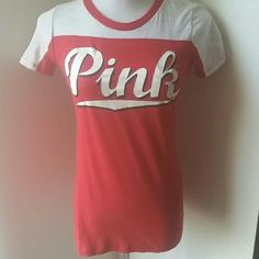 PINK T NWOT. No holes. No stains. No pilling.  Mint condition!  Tag list as a small, but they are a fitted medium with a straight cut.  Please refer to measurements.  Armpit to armpit is 14 1/2 inches.  From top to hem is 25 1/2 inches.  Sleeve measures 6 inches.   ⚠Please make offers thru the OFFER TAB ONLY. I DO NOT negotiate on the listing. Bundles receive 15 % off using bundle feature ⚠  ❌No trades  ❌No modeling PINK Victoria's Secret Tops Tees - Short Sleeve