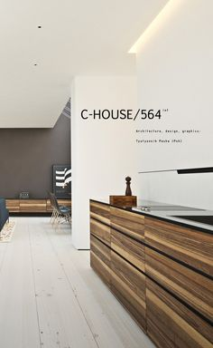 C-House Office Reception Desk Design | Love the Striped Wood