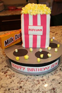 drive in movie reel and popcorn cake -