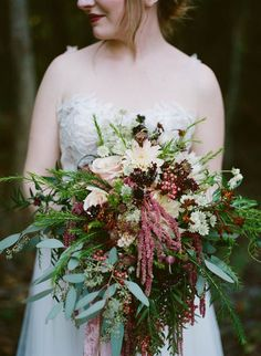 Fall wedding bouquet in cranberry, ivory, and green | Image by Maile Lani