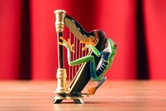 You've got to check out this Etsy shop. Very creative, funny stuff . . . with live frogs!  http://www.etsy.com/listing/93717613/harp-frog-harpist-music-art-musical