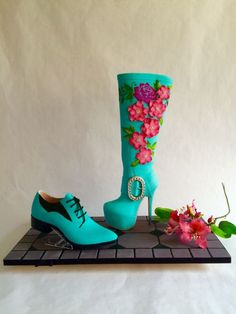 Teal colored high heel boot