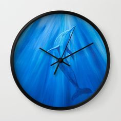 Dolphin in blue  Wall Clock