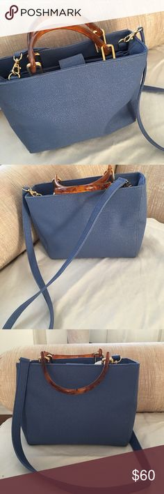"""Beautiful bag Gorgeous bag  snap closure gold hardware plastic handles and Crossbody strap snap closure three compartments middle compartment zips one inside zipper pocket flat bottom  dimensions are11""""cross  8"""" deep 3"""" bottom  Great bag for fall dress up or wear with blue jeans Preston and York Bags Crossbody Bags"""