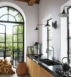 so bright, clean, & organic... love the thick counters, sink, and faucet.  it's like spanish (the bones) meets seaside (the lights) meets asian (the cabinets & clean lined thick counters)  i love when all things come together someone likes