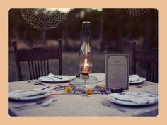 A vintage oil lamp will be centered in the middle of each table.