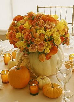 White pumpkins as vases for wedding reception tablescape.