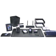 "Sixteen-piece black leather desk set. Includes: 34"" x 20"" side-rail desk pad, 2 front-load letter-size trays, pencil cup, 4"" x 6"" memo holder, letter holder, business card holder, letter opener, double pen stand, staking tray posts, square waste basket, mouse pad, keyboard pad, desktop calendar holder, desk clock, 4"" x 6"" picture frame. Genuine top-grain leather."