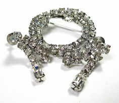 Vintage Mad Men Style Rhinestone Brooch and Earrings from jewelry by @na la https://www.etsy.com/listing/97765662/vintage-mad-men-style-rhinestone-brooch #vintage #jewelry #rhinestones #Hollywood Regency #sparkle #gifts