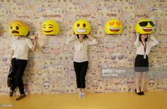 Passers-by pose for photos with emoji hats fixed on a wall in a shopping mall in Guangzhou on May 2016 in Guangdong, China. Interactive Exhibition, Interactive Walls, Interactive Installation, Artistic Installation, Stand Design, Booth Design, Photo Booth Backdrop, Poses For Photos, Experiential