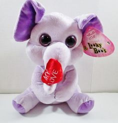 "Looky Boo's Purple Elephant. Sugar Loaf 10"" Plush Animal. Holding a ""My Love"" Red Heart with it's Trunk. This toy is Stuffed Green. It is filled with Eco-friendly polyester made from recycled plastic bottles. ..... Visit all of our online locations..... www.stores.ebay.com/ourfamilygeneralstore ..... www.bonanza.com/booths/Family_General_Store ..... www.facebook.com/OurFamilyGeneralStore"