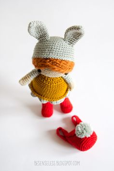 Amigurumi Bunny doll, easter bunny crochet find keepers doll with grey hat, yellow dress, boots and red rucksack with a grey pompom