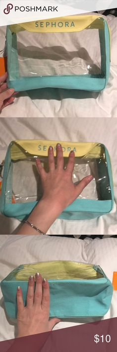 Large Sephora Makeup Bag Light blue and yellow across the top, bottom and sides, but a clear plastic on the main body so you can see what you have in it. It came with the Summer 2016 Sun Safety kit. I never used it, but there is a spot of makeup by the zipper as shown in the 4th picture. Sephora Bags Cosmetic Bags & Cases