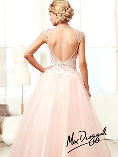 Fit for a princess this lovely A-line gown has a long silhouette.  Slight sweetheart neckline, with an illusion overlay.  Jewels, bead and sequins on tulle add style.