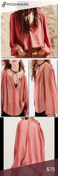 FREE PEOPLE Blouse In an effortless, oversized fit this sheer blouse features metallic stripes, plunging V-neckline and metal grommet detailing. Long sleeves with elastic cuffs.  81% Rayon 19% Cotton Machine Wash Cold Free People Tops Blouses