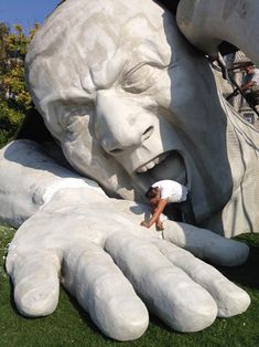 """giant angry man in Budapest, shown during installation. This magnificent large-scale sculpture by artist Ervin Loránth Hervé. The sculpture, entitled """"Feltépve"""" (meaning quite appropriately, """"Ripped Up""""), was constructed out of polystyrene. Things took a couple of days longer than planned for the artist, as getting the underlying ground leveled properly provided some challenges. Unfortunately, the giant angry man was only a temporary installation and has been removed."""