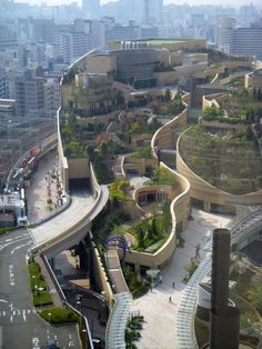Namba Parks, an office and shopping complex in Osaka Japan. It features a commercial center crowned with a rooftop park, tree groves, cliffs, streams, waterfalls, ponds and streams crossing multiple blocks that descend eight levels.
