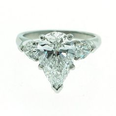 Platinum Pear Shaped Diamond ring with Pear shaped side stones | Yelp