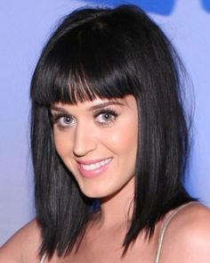 Katy Perry http://www.qwallpapers.com/thumbnails/large_Katy_Perry_Hair_Cut_7501.jpg