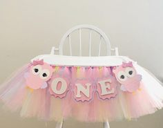 "Colorful owl themed high chair banner! The perfect addition to your owl themed celebration! Look WHO's turning one! This fun and colorful banner comes in two strands, one with ribbon and tulle and the other with cute owls and bow and the word ""one"" spelled on high quality card stock. Please choose"